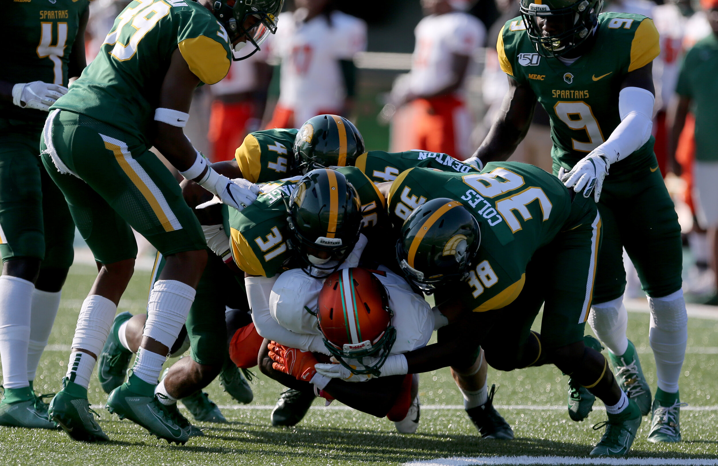 Norfolk State defenders Brandon Savage (31) and Devyn Coles (38) stuff Florida A&M's George Webb during third quarter action of the Spartans' 28-30 loss, Saturday, September 28, 2019 at Dick Price Stadium in Norfolk.