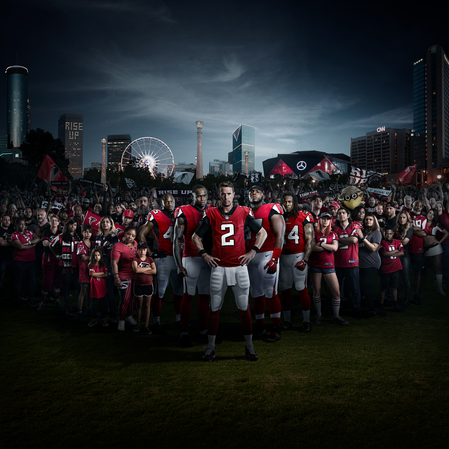 "Atlanta Falcons Together We Rise - Through our commitment to each other we can achieve greatness both on and off the field. Simply put, we are stronger, and better, together. While Rise Up answers the question ""What do Falcons do?"", Together we Rise answers ""how"" and ""why"" we do everything we (not just the team, but all of Atlanta) do.How do we do it? Together.Why do we do it? For the betterment of one another."