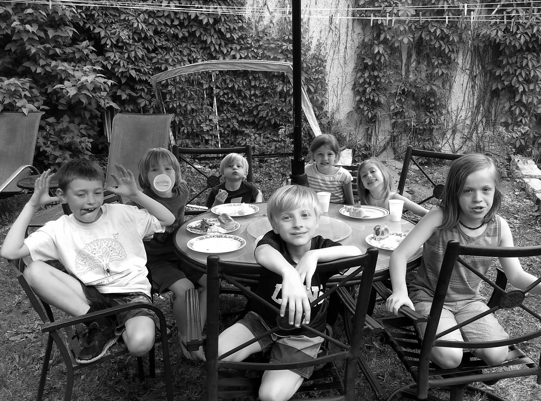 Friday night dinner outside. The community kids had the right idea, sitting under the patio umbrella as the sprinkling rain dampened the yard, but not our spirits!