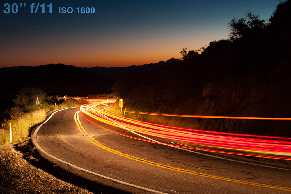 I captured this image of a mountain road with my camera on a tripod set to a long 30 second exposure (the maximum setting on many cameras without a remote shutter release) as a vehicle approached.