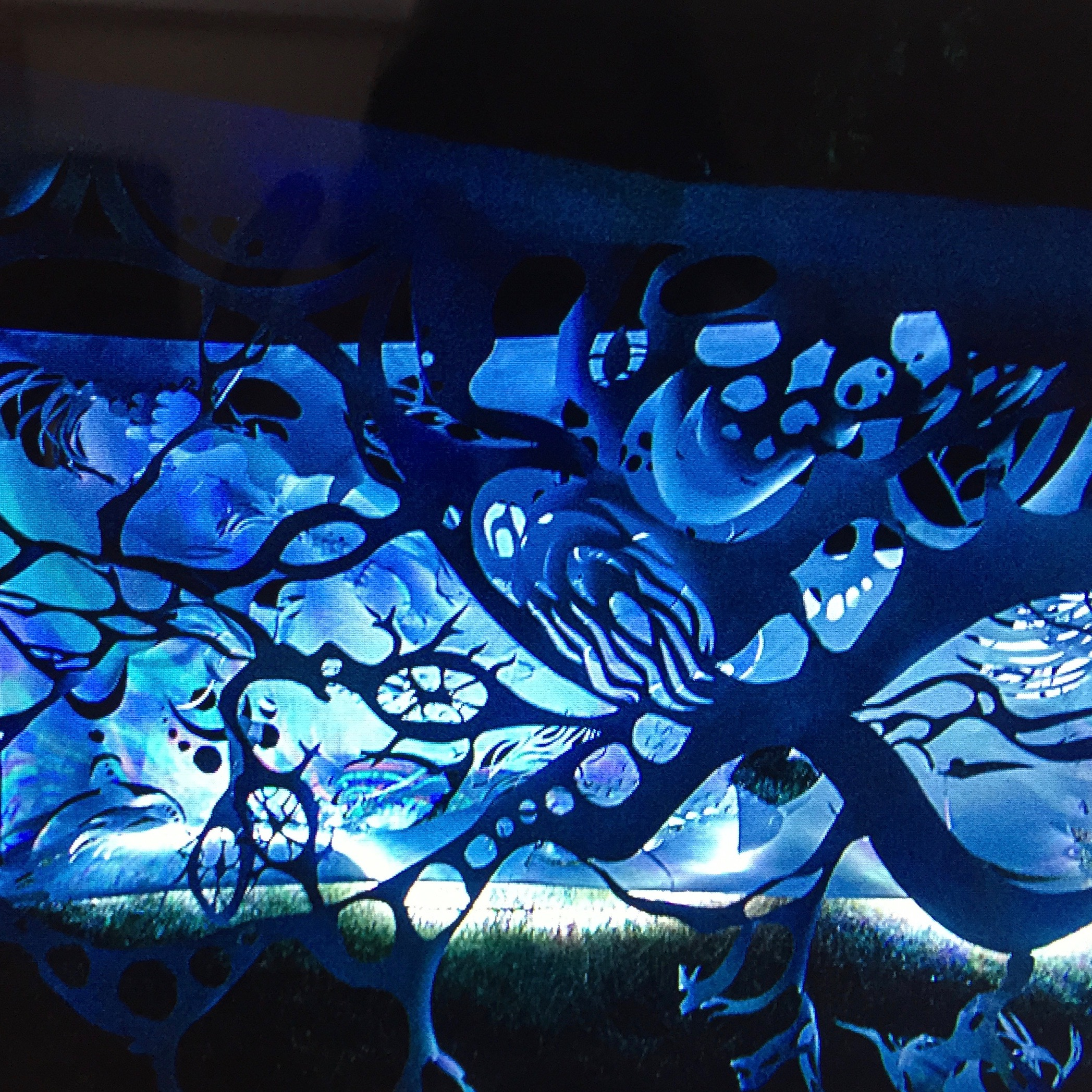 Illuminated papercut scroll by Masha Lopes. Photo by Din Dins.