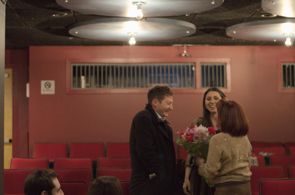 Damon and Lauran being given bouquet of flowers