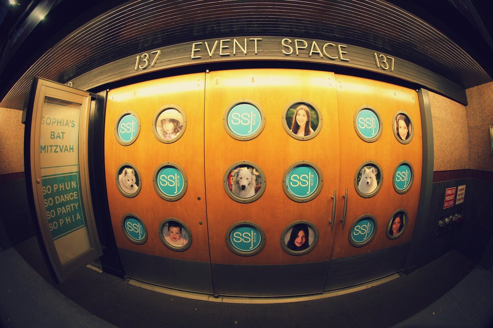 Sophia's Bat Mitzvah at HELEN MILLS - Exterior signage with photos of the mitzvah party girl in each of the portholes.