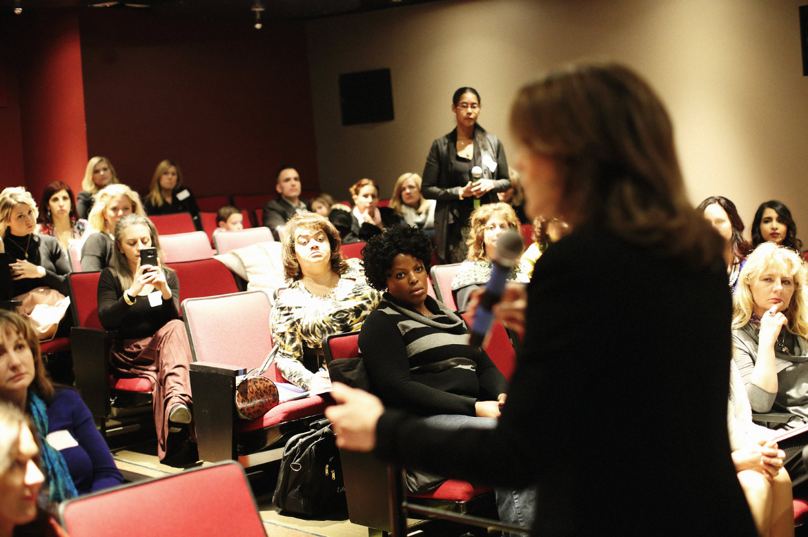 Guests participate in a Q&A session in the HELEN MILLS Theater.