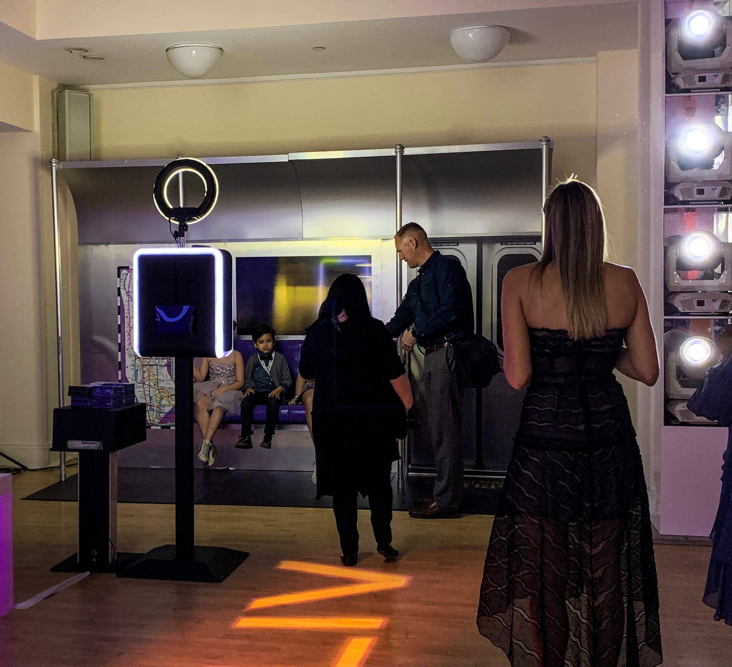 Guests using photo booth