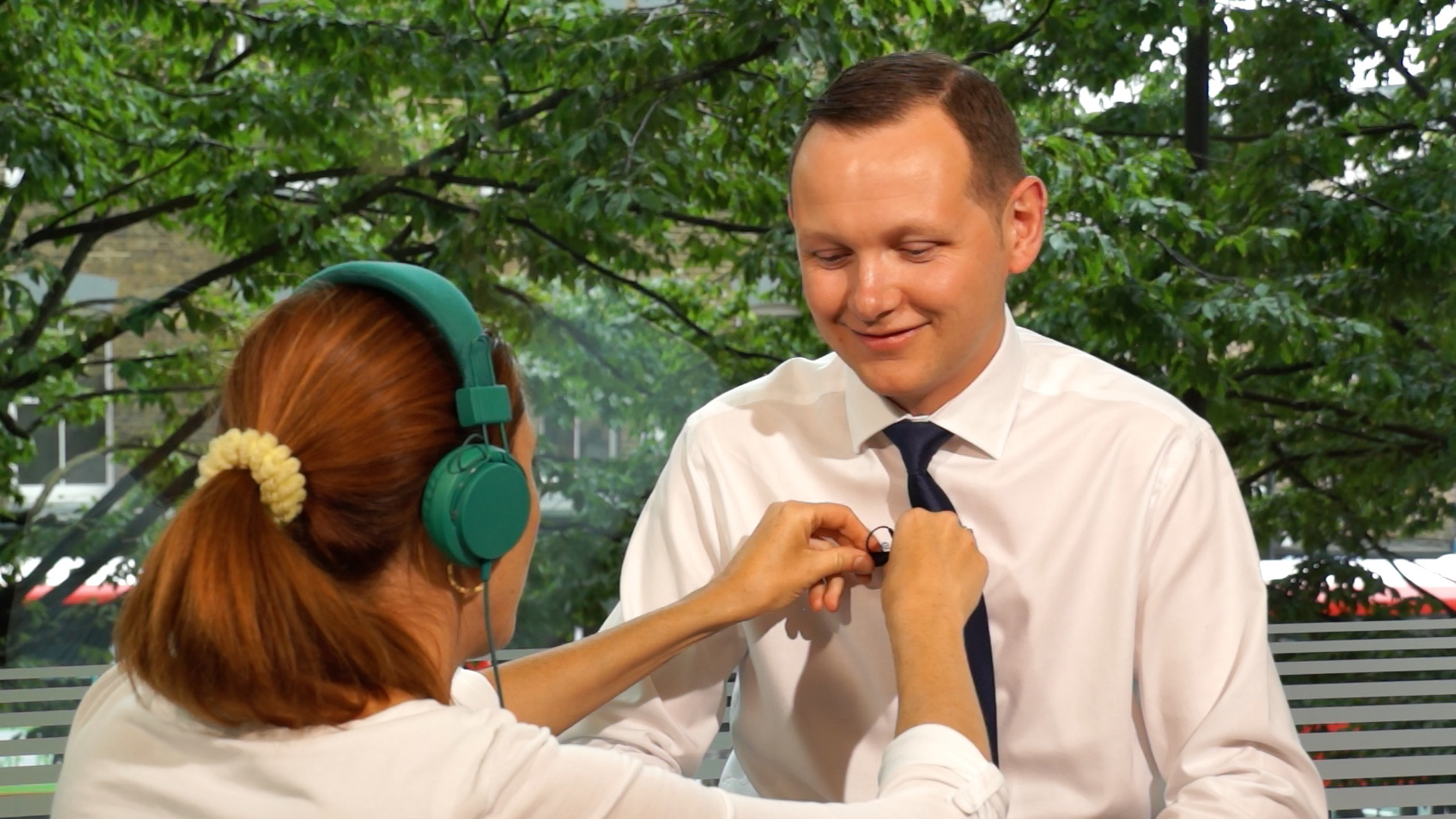 Adjusting microphone during the shoot