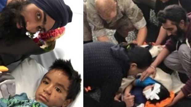 Harman Singh meets Daejon Pahia, 6, after tending to him on a road in Takanini, South Auckland.  Photo: Supplied