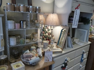 Chest of drawers, artwork, soaps.....