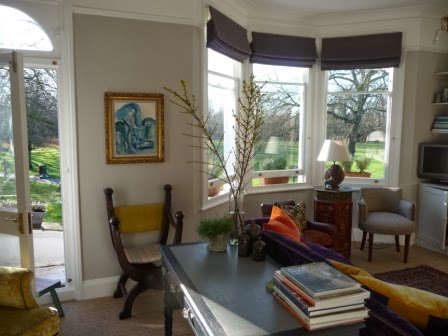Three tall stems of forsythia in a vase in the sitting room to feel like spring