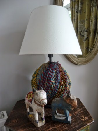 I have added two old wooden hand-carved Indian cows to complement the lamp base.