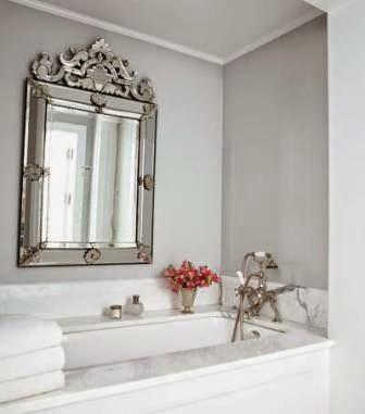 A Venetian-style mirror adds elegance to a bathroom