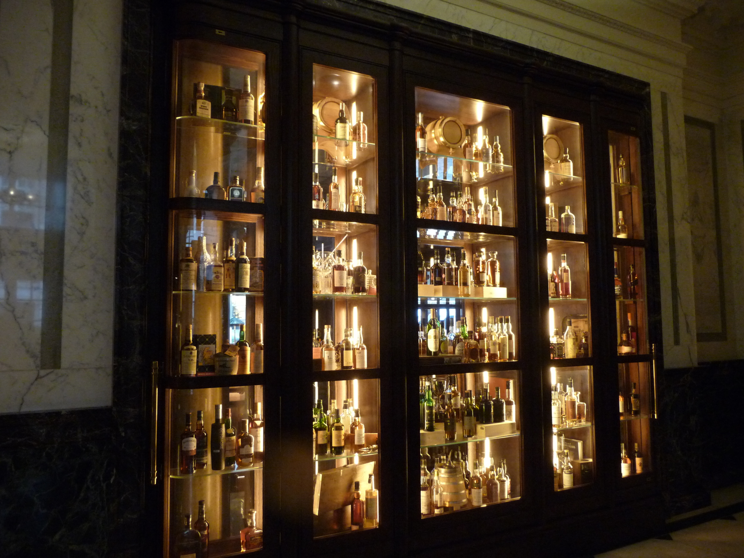 A cabinet of bottles outside the Scarfe bar