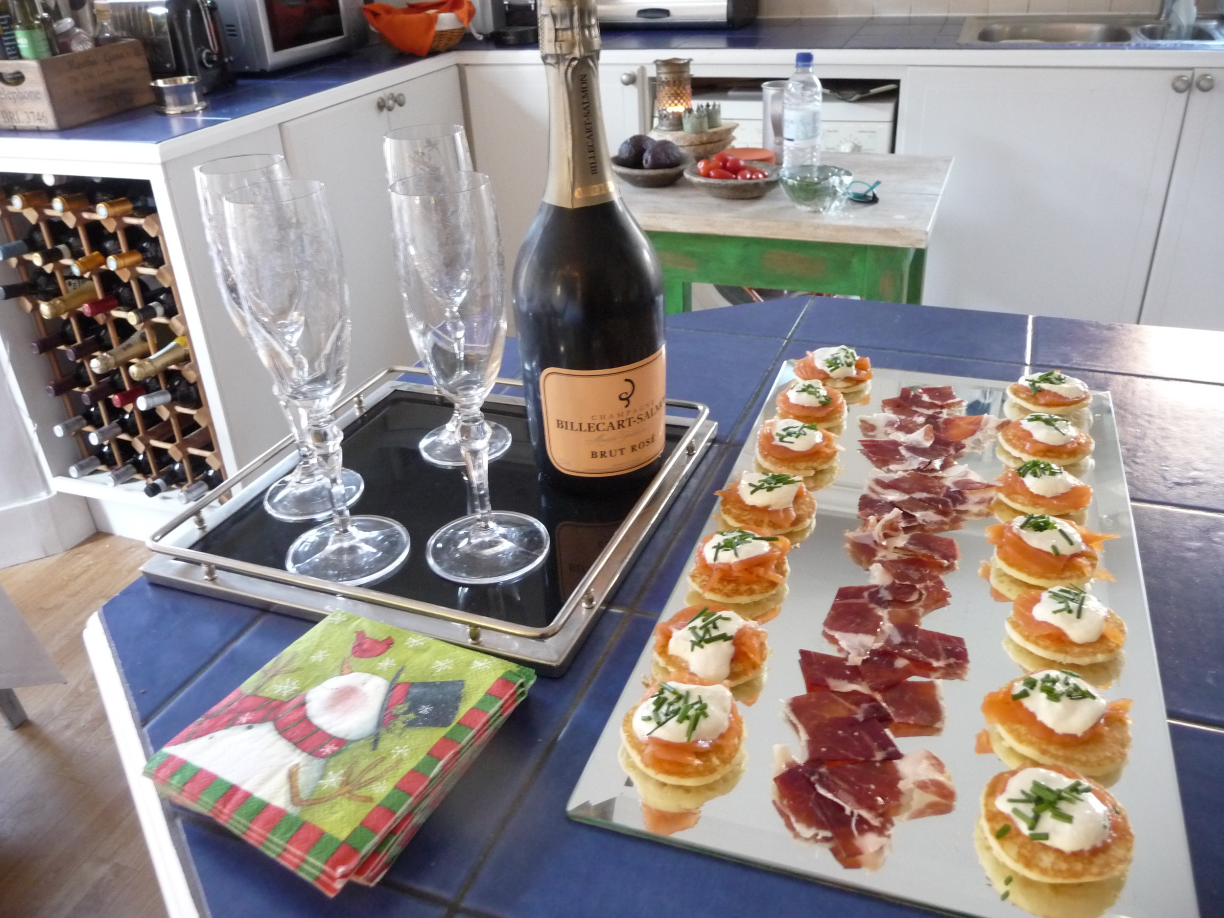 Smoked salmon blinis and Iberico ham with Billecart Salmon Rose champagne at noon