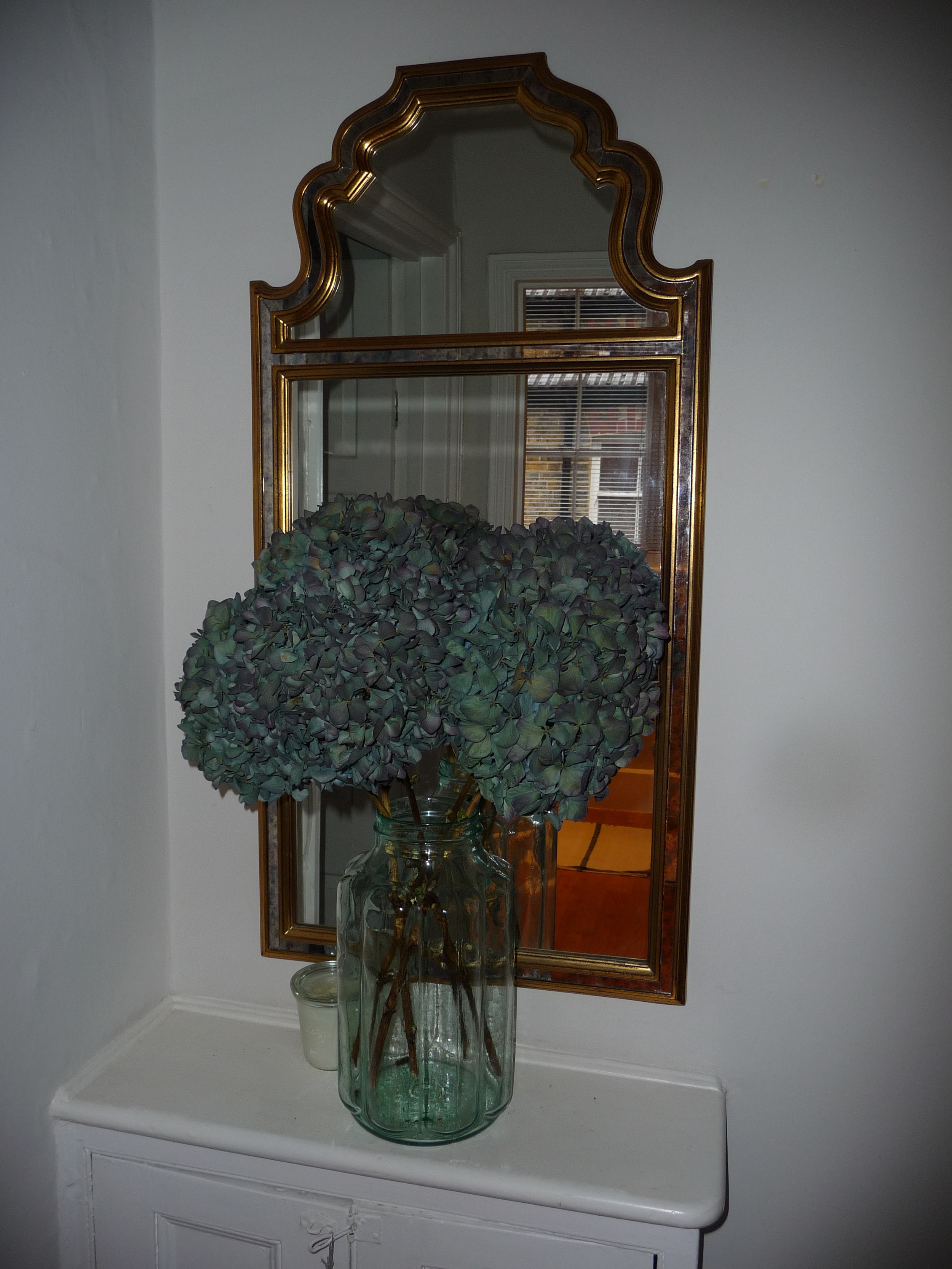 A huge preserving jar of dried blue hydrangeas