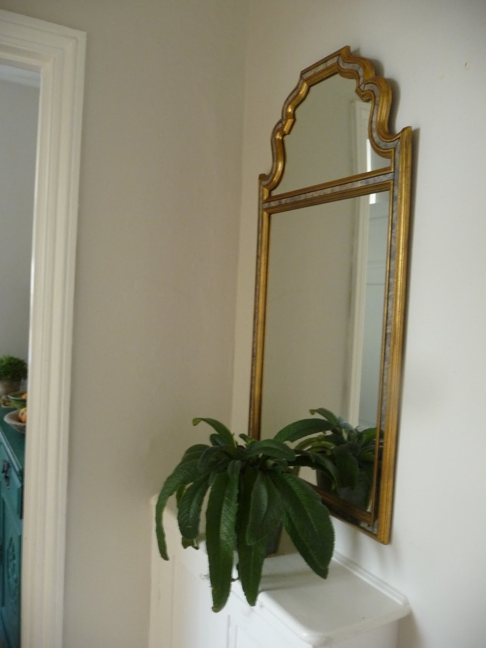 I found this mirror in a second hand book shop of all places. It is made in Belgium and is rather unusual. It is placed opposite the bathroom so reflects light from the bathroom window