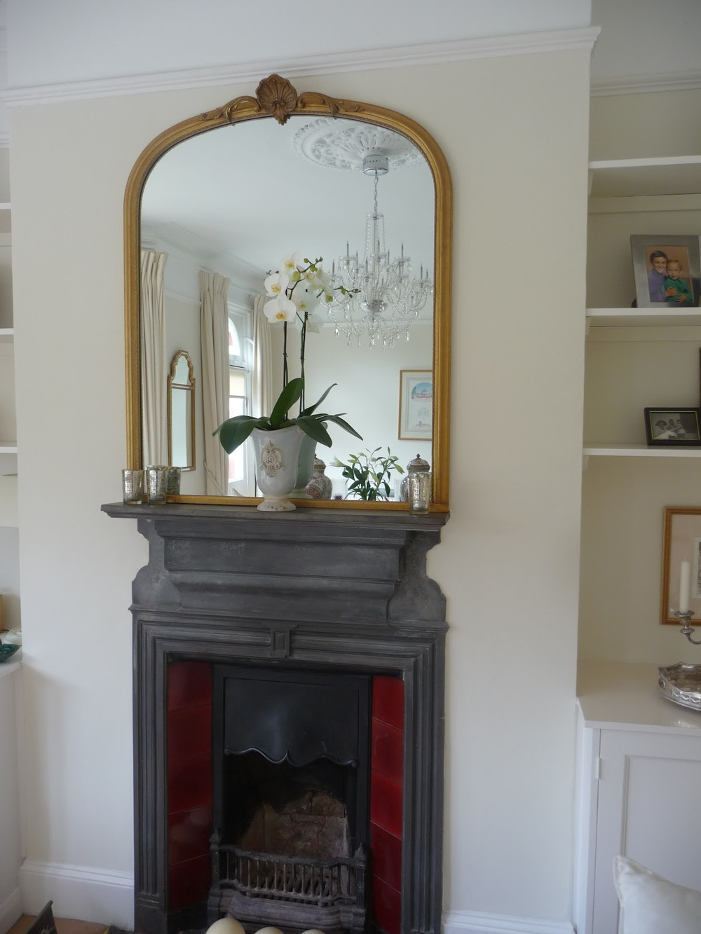 A large mirror over a fireplace always works. I chose this one as it fitted between the fireplace and the picture rail, maximising the space.