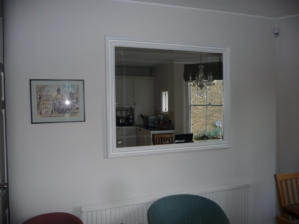This is a very large pine mirror in my kitchen that serves the purpose of creating light. It's not a feature mirror as it has no redeeming features so I've painted it the same colour as the wall. I would recommend that when you buy mirrors, you buy for their features rather than practicality.