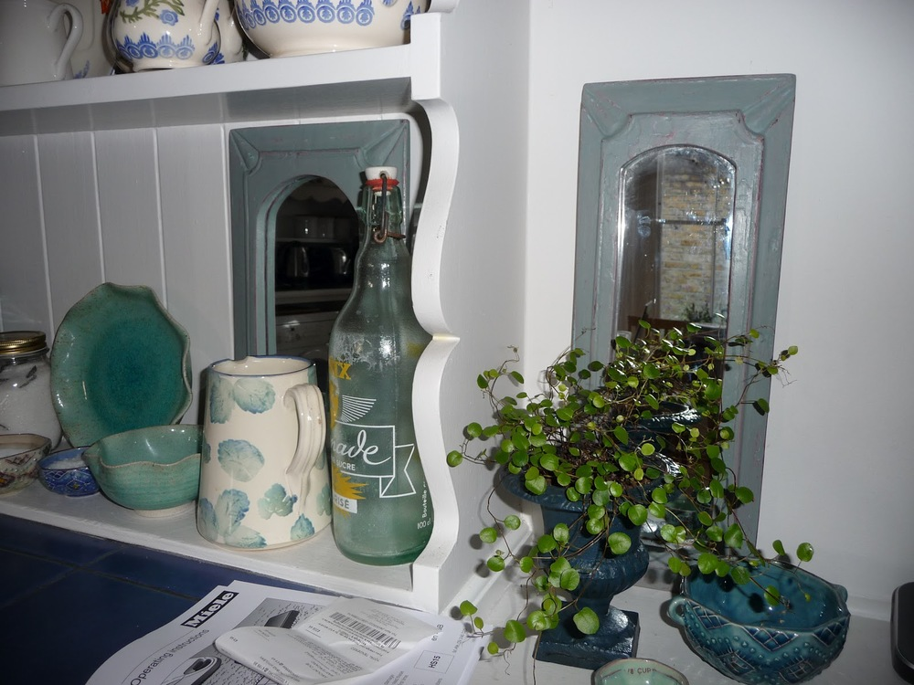 Two little mirrors from Quirky Dovetail in Balham which I repainted in two Annie Sloan colours - Scandinavian Pink and Duck Egg Blue. I use them on this shelf as decorative items.