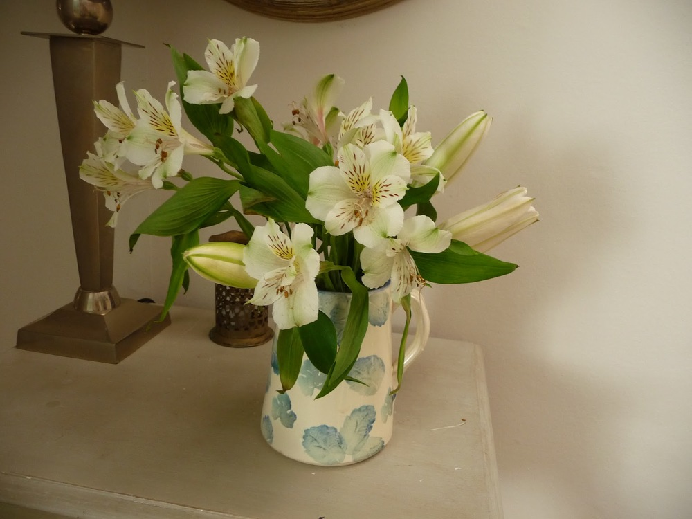 Two-week old Alstromeria and lilies cut down to squeeze another week out of them. The jug was a great charity shop find at £3!