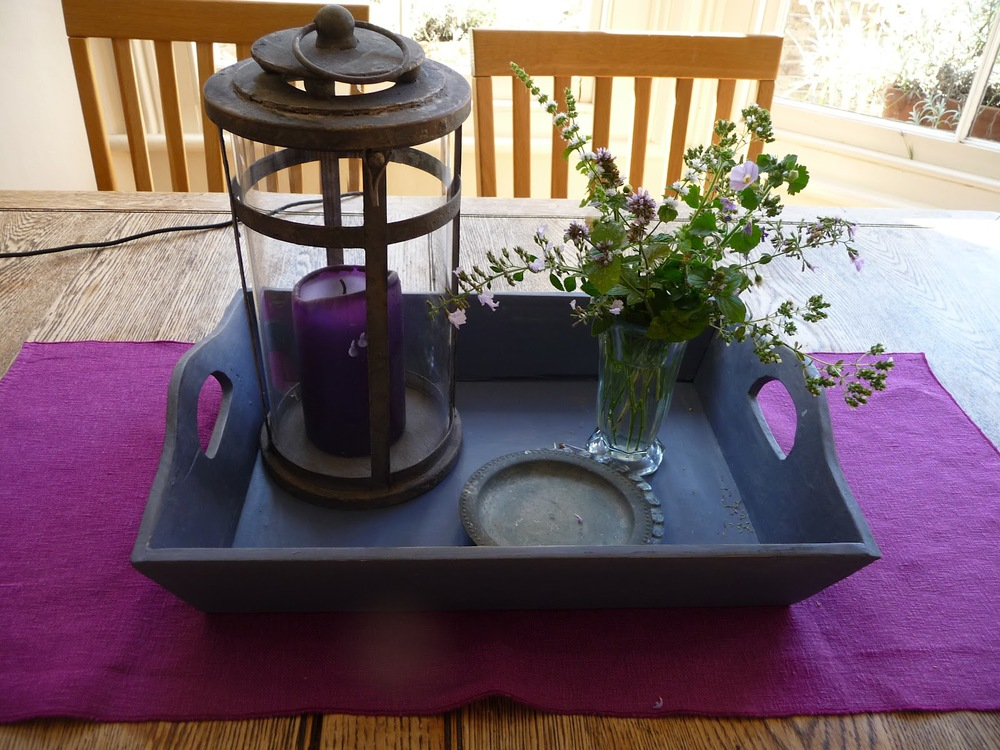Delicate sprigs of herb flowers on the kitchen table. I painted this tray in Annie Sloan 'Old Violet.
