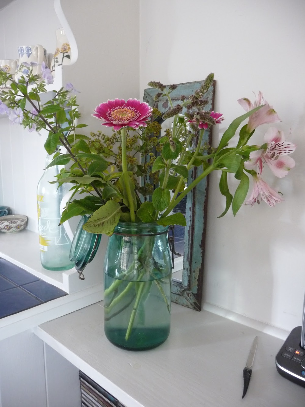 It's not necessary to have a vase crammed with flowers. Just a few stems like this gives each flower space to show off its beauty. And this vintage French jar, a great find from  Phoenix on Golborne  makes a great vase.