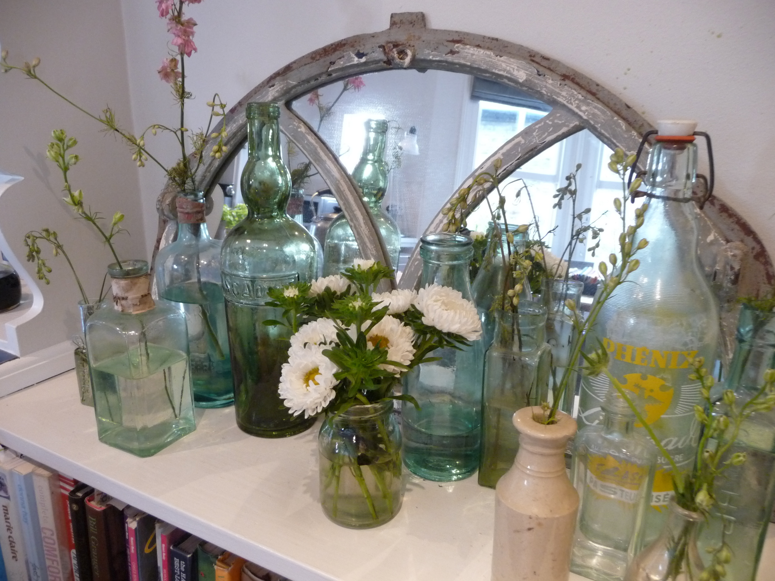 My vintage bottles with the offshoots of other flowers I've bought. The little jar of white Asters were the offshoots also