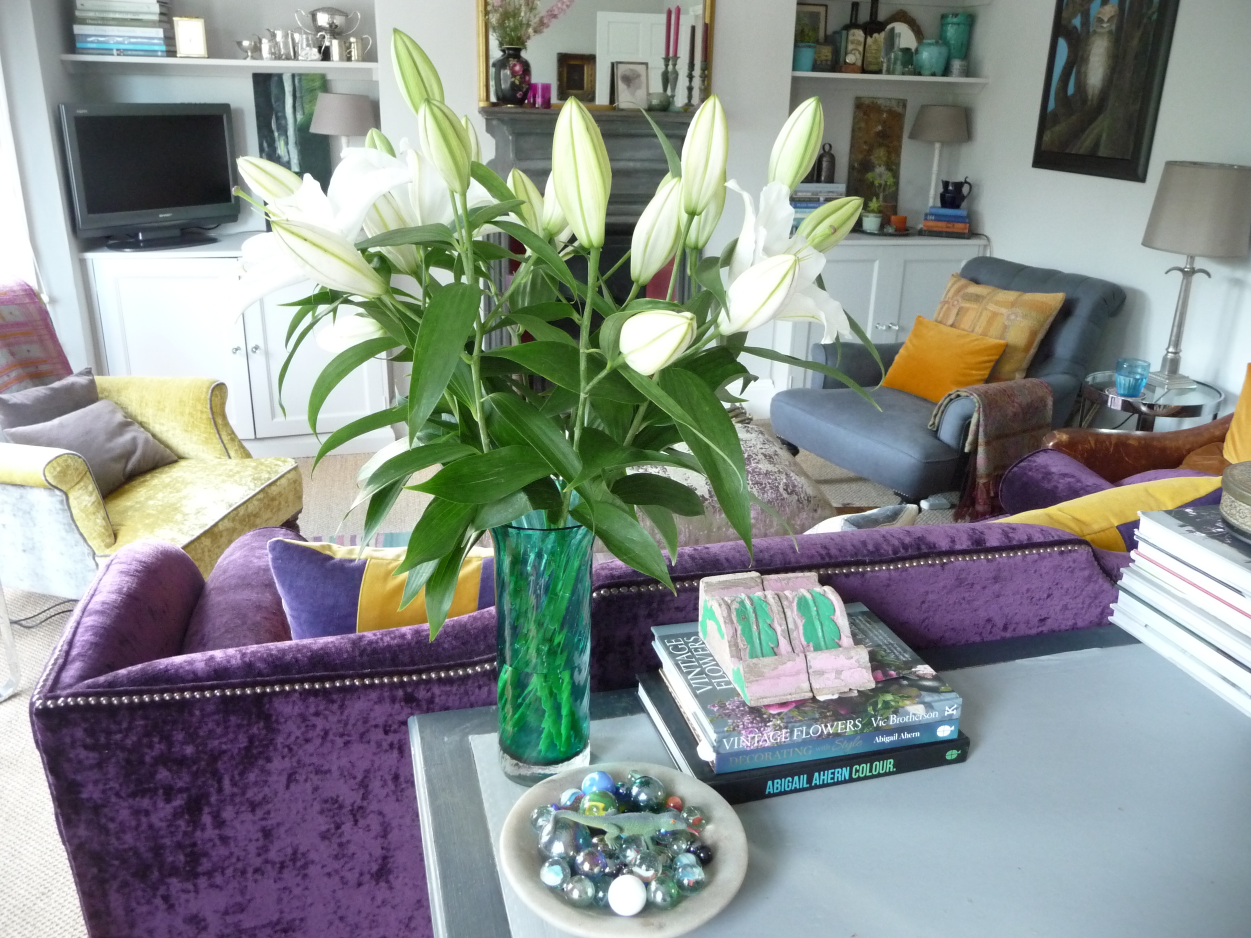 Glass vase of white lilies to add scent to the sitting room. Remember to remove the pollen from each flower as it opens or you could end up with horrible stains on your furniture or carpet.