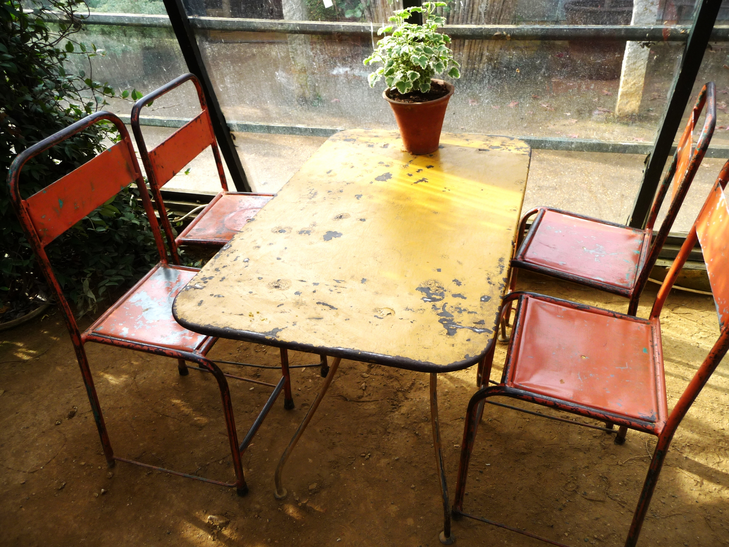 These are the gorgeous rustic vintage tables and chairs that they have in the glasshouses and outside where you can sit and eat