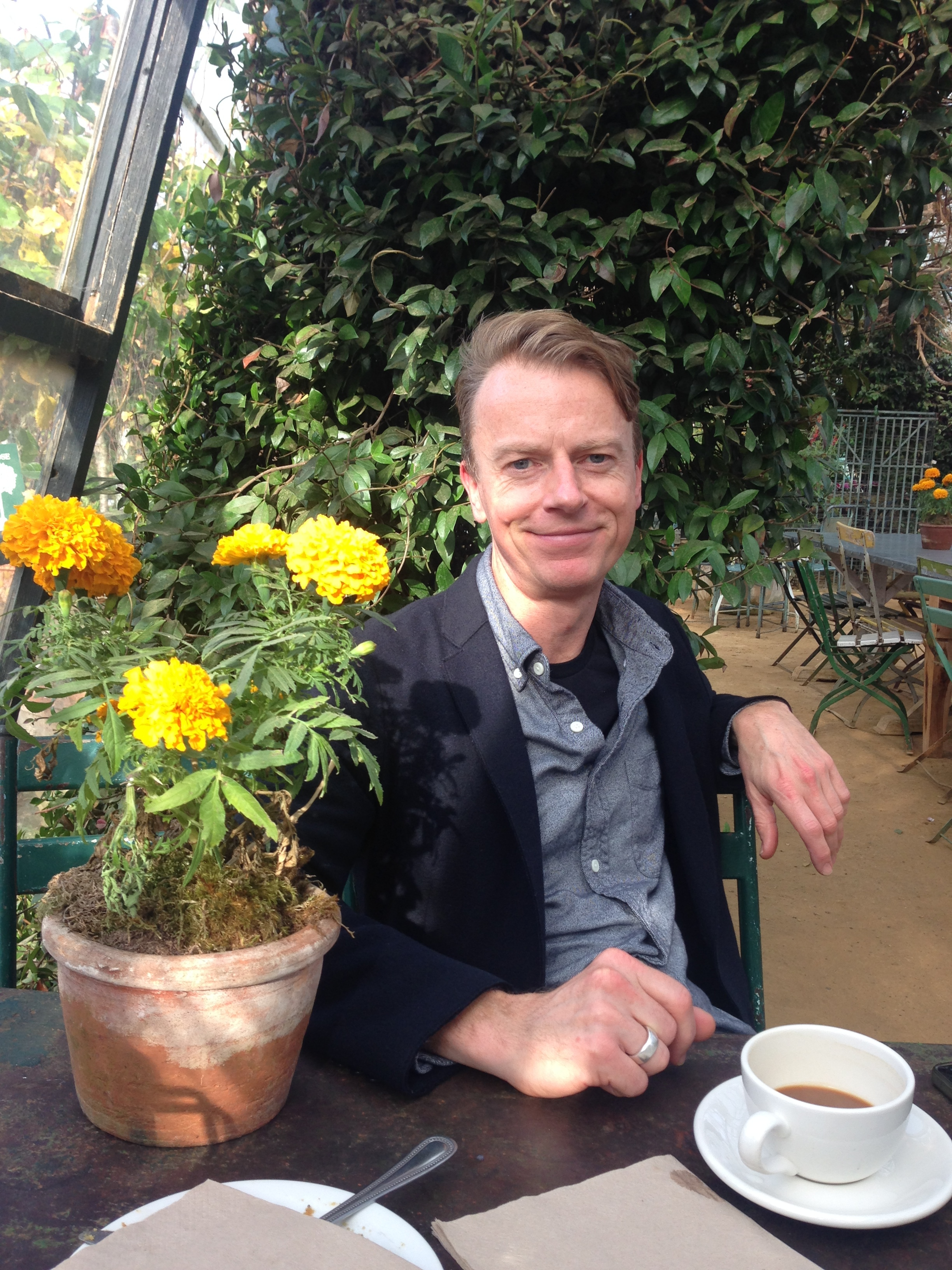 My friend Nick in the glasshouse where we were having coffee and cake.  I am not a lover of marigolds but a terracotta pot of them on the table looked gorgeous