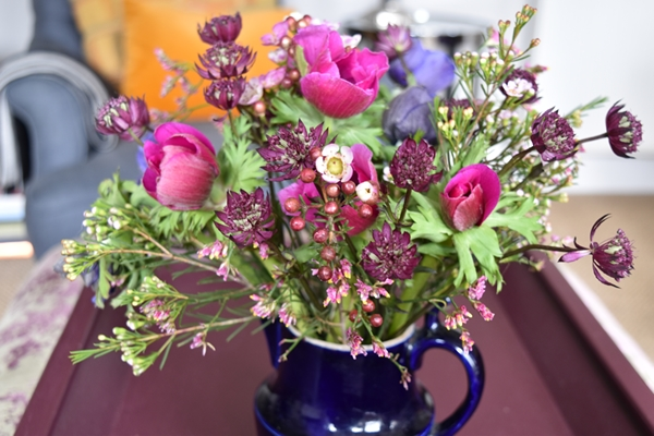 This is a little vintage jug of anemones enhanced with off-shoots from long stems of wax flowers and Ericas that I bought to fill some vintage bottles