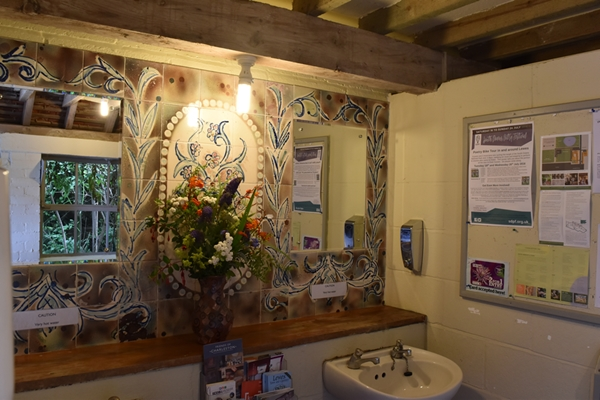 Even the ladies' bathroom is beautifully decorated with paint effects, handpainted tiles and flowers from the garden!