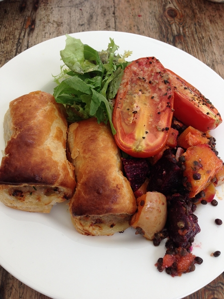 Sausage rolls with roasted tomatoes and lentil salad