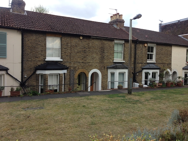 Rather strange frontage below ground level to this row of Victorian cottages