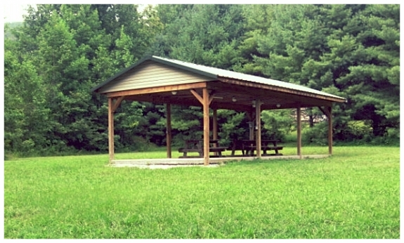 Picnic Shelter - Our 10' x 30' Picnic Shelter sits adjacent to the Campground. Not only is it in close walking distance to the bathhouses, it also offers easy access to the creek. The Picnic Shelter has water, lights, electrical outlets, and a large fire pit.Rental Cost: $50