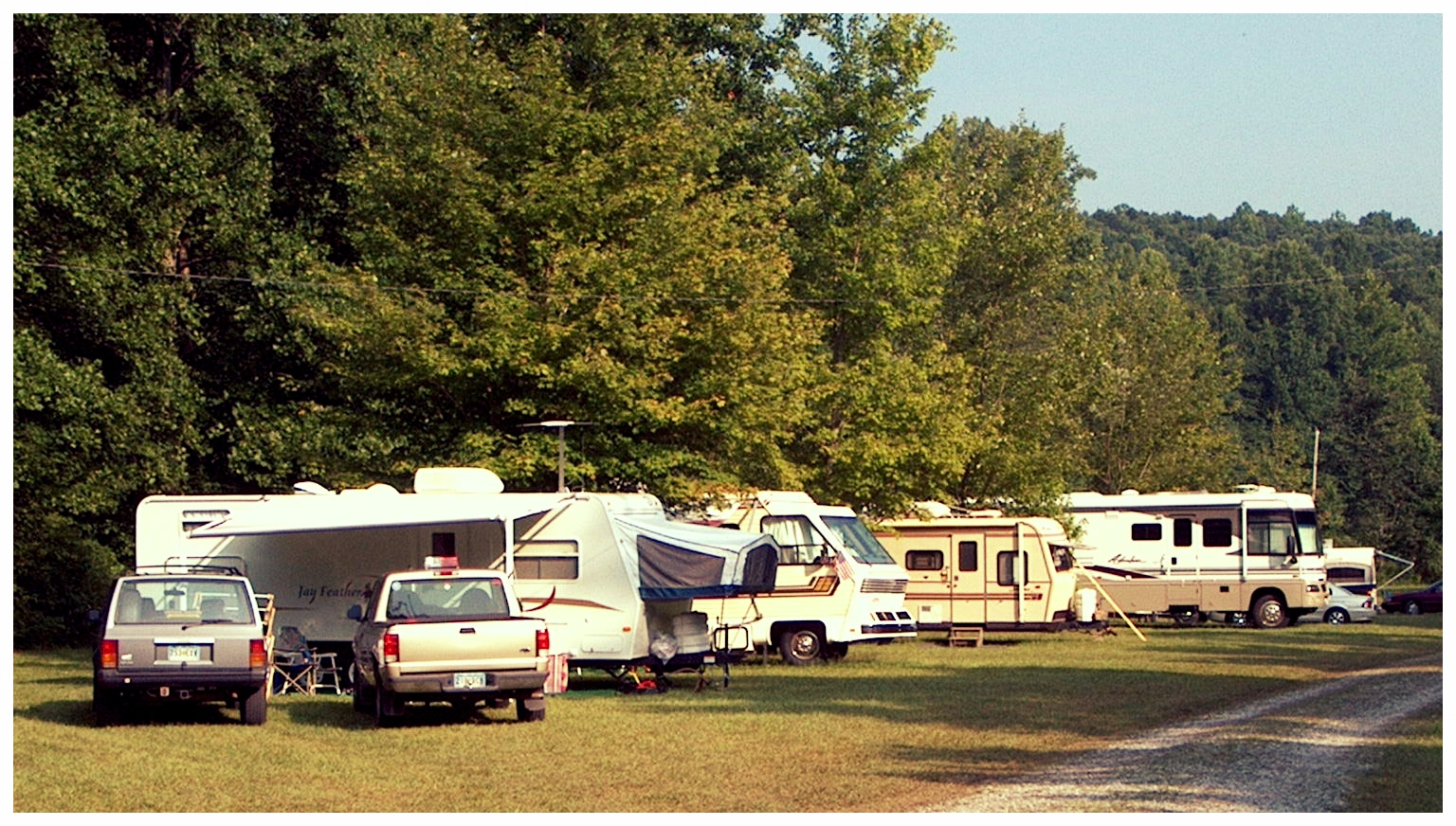 The Campground - Running parallel to the creek bed is our 22 site campground. Each site is equipped with brand new (2019) water and electric hook ups. There is also a dump station located nearby. The bathhouses and picnic shelter are both in close walking distance to the campground.Rental Cost: RVs- $25/night, Tents- $16/night