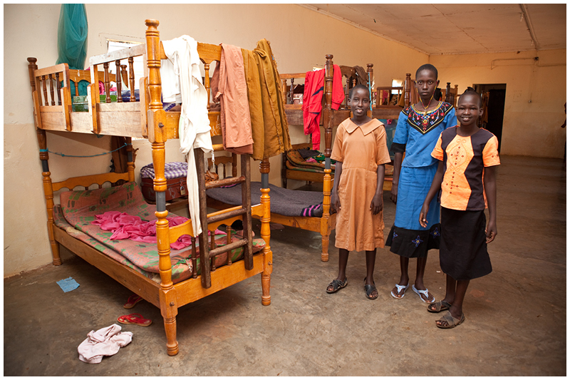 This is the girls' dormitory at Kipsing Primary. The girls on the right have finished their exams and are going home for the holidays. Going home for the holidays is always an uncertain experience for these girls. Although they miss their families, they are often prevented from coming back, or fall pregnant while on holiday and are forbidden from coming back to school.