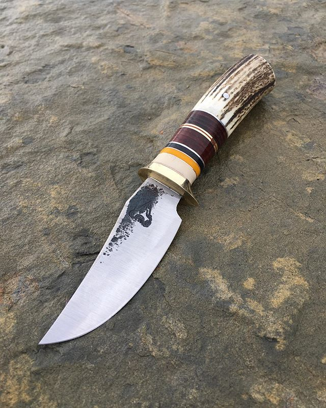 This knife has been a bit of a nightmare! It has gone through two failed heat treats that made the blade absolute brittle garbage which also means that this is its third handle. However we finally nailed down this piece of 01 and it's ready for hunting season! The last photo is of its first inception.
