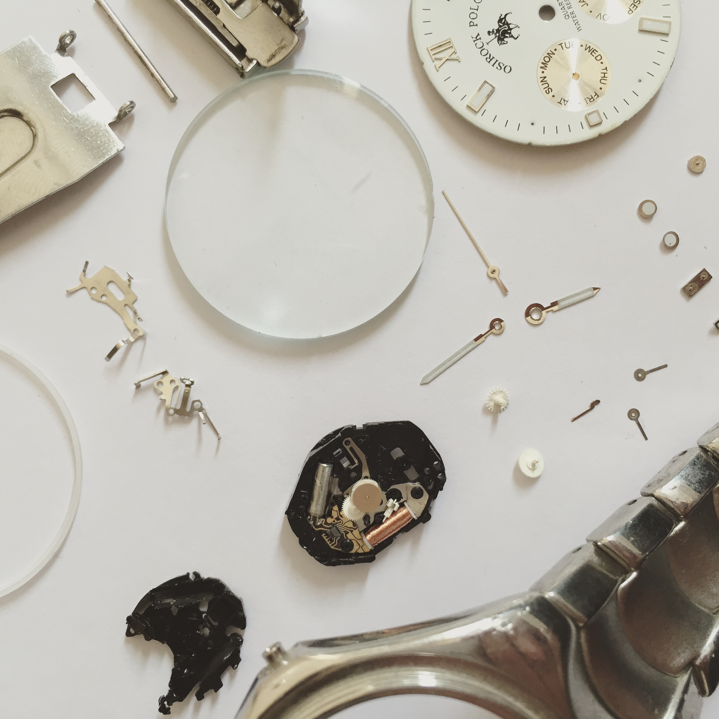 """Parts Of a Quartz Watch, """"the dragon head"""", the grey cylinder is where the quartz is!"""
