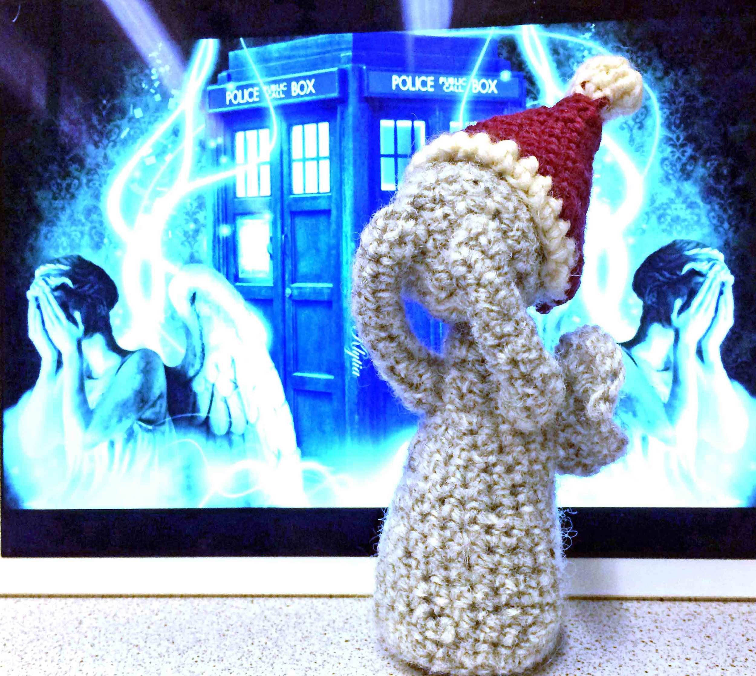 Weeping Angel with jaunty Santa hat