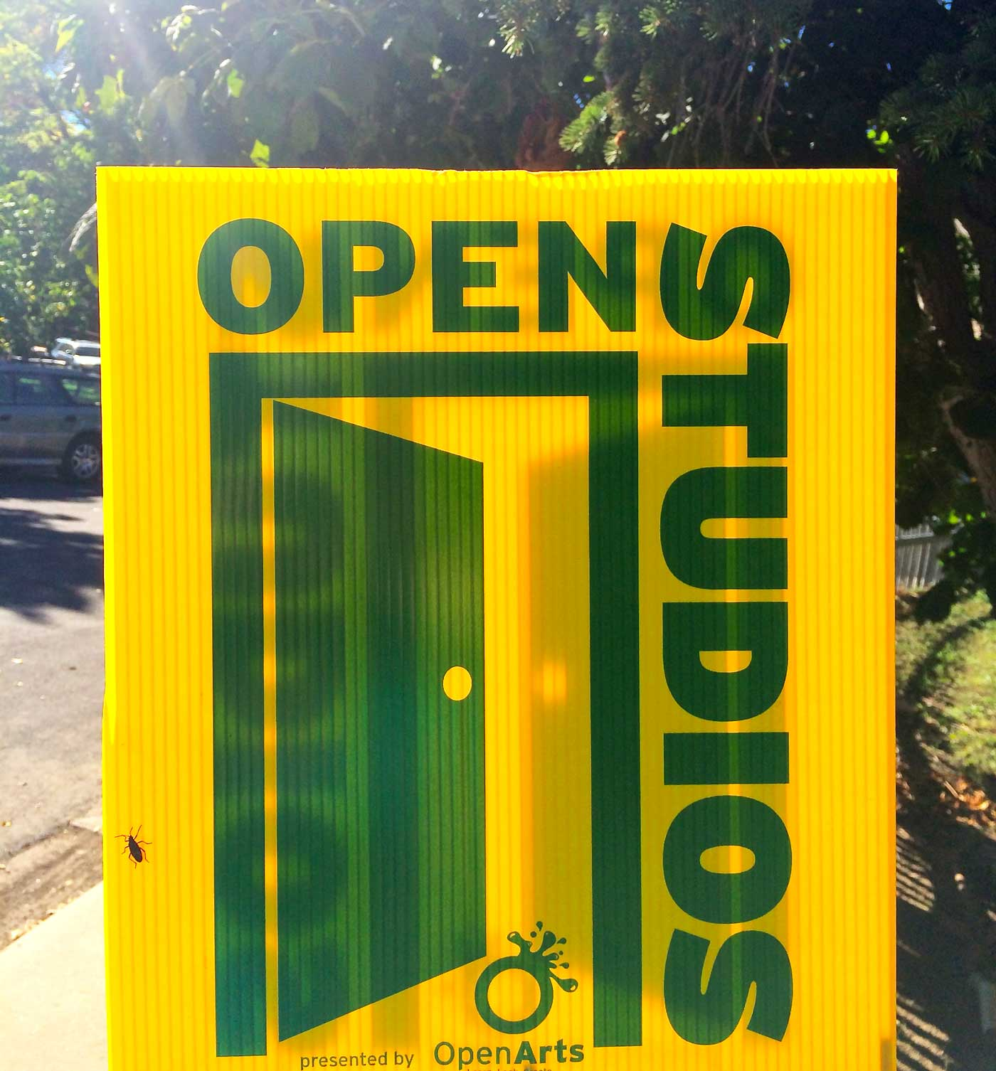 These little yellow signs are posted in front of the studios to help guide the way.