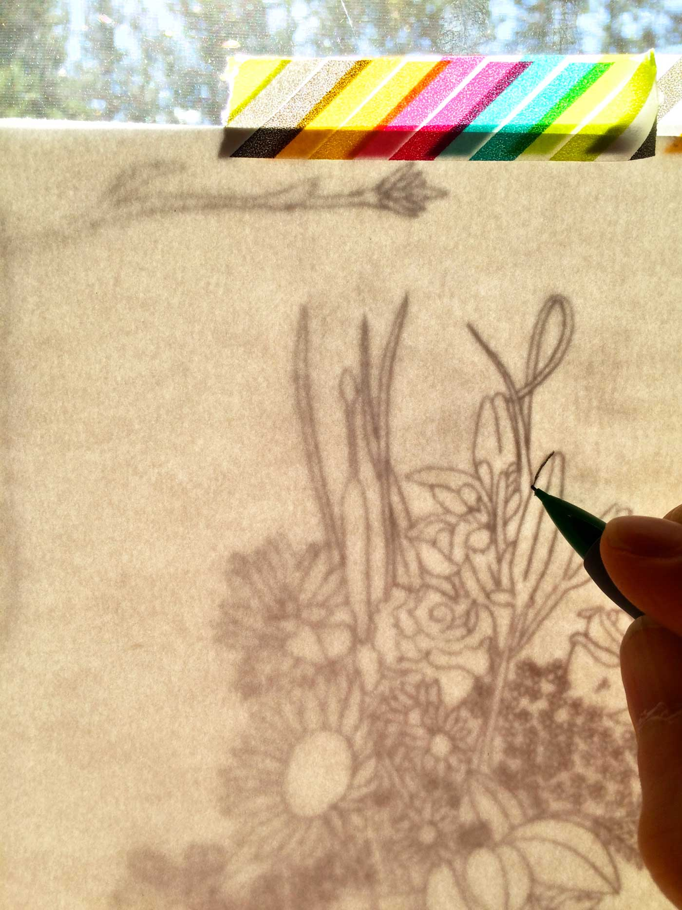 Trace over your lines with a marker or pencil. I like to use a mechanical pencil and then ink.