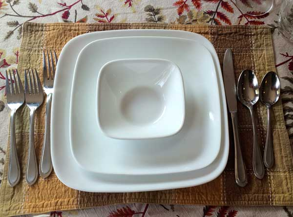 For this example I used some every day white plates but you can have lots of fun mixing and matching to your heart's content. See how the setting can even make everyday dishes look fancy? Also note the placemat and tablecloth were purchased separately but they still go together (thanks, mom!)
