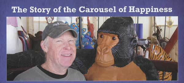 This is the man that made it all happen sitting next to one of his creations. (Photo courtesy of the Carousel of Happiness, James DeWalt, Tom Walker, and Kay Turnbaugh.)