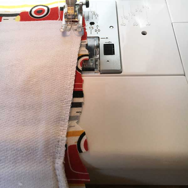 Sew around the perimeter of the diaper cloth, close to the edge. When you are finished, trim any excess fabric around the edges being careful not to cut any of the lines you just sewed.