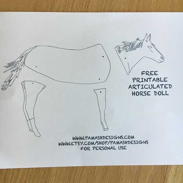 First, print out your free PDF file. I would recommend printing this on some heavy white paper so your doll will be a little more sturdy (some white cardstock). If you plan on using watercolor, you may want to print on watercolor paper. I printed on a heavy weight construction paper.