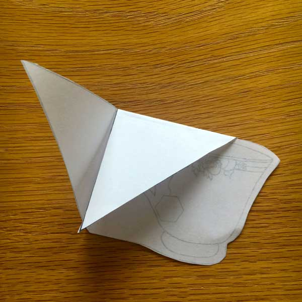 Turn it over and fold down the top triangle.