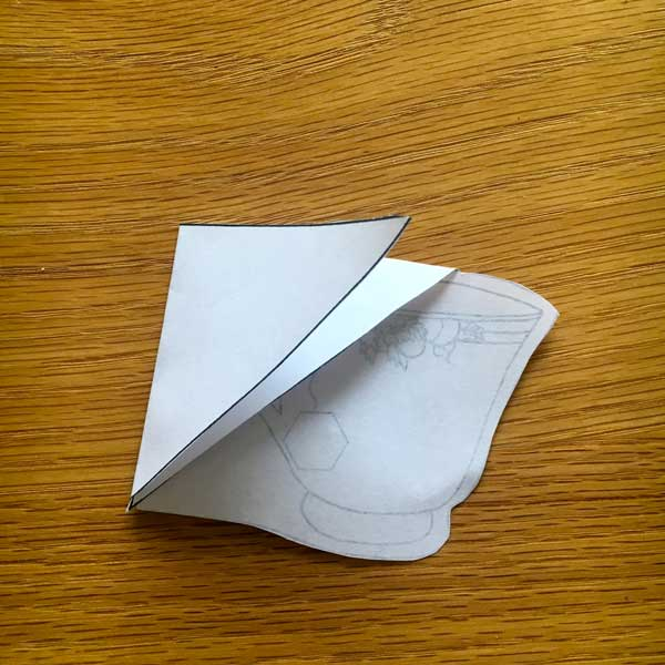 Next, fold the other triangle down to make a pocket.