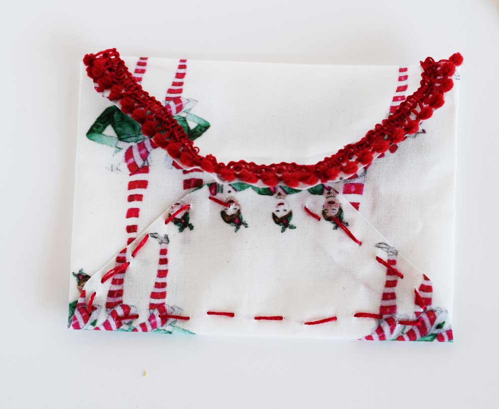 Above is an example using some embroidery to add a little detail and sew the bottom of the envelope closed.