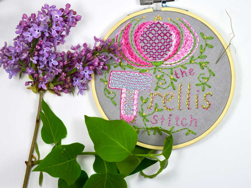 Fun and quick to learn, the TRELLIS STITCH is a charming way to add a decorative filling stitch. Here I incorporated it in a botanical theme.