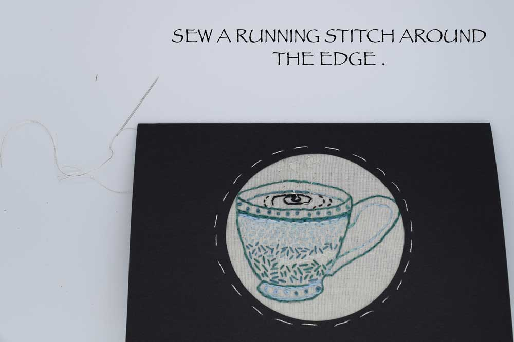 I added the  RUNNING STITCH  around the edge if the circle. This serves two purposes. It attaches the fabric firmly to the card and adds a pretty decorative element.